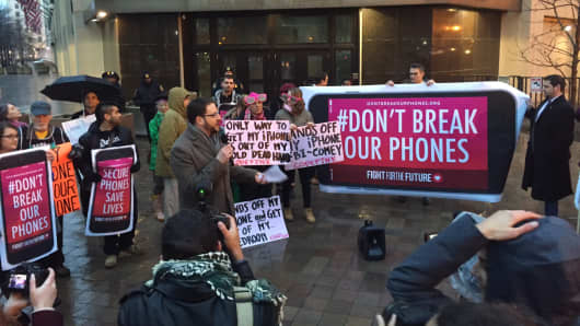 Apple supporters protest outside the F.B.I. headquarters in Washington, D.C. on Feb. 23, 2016.
